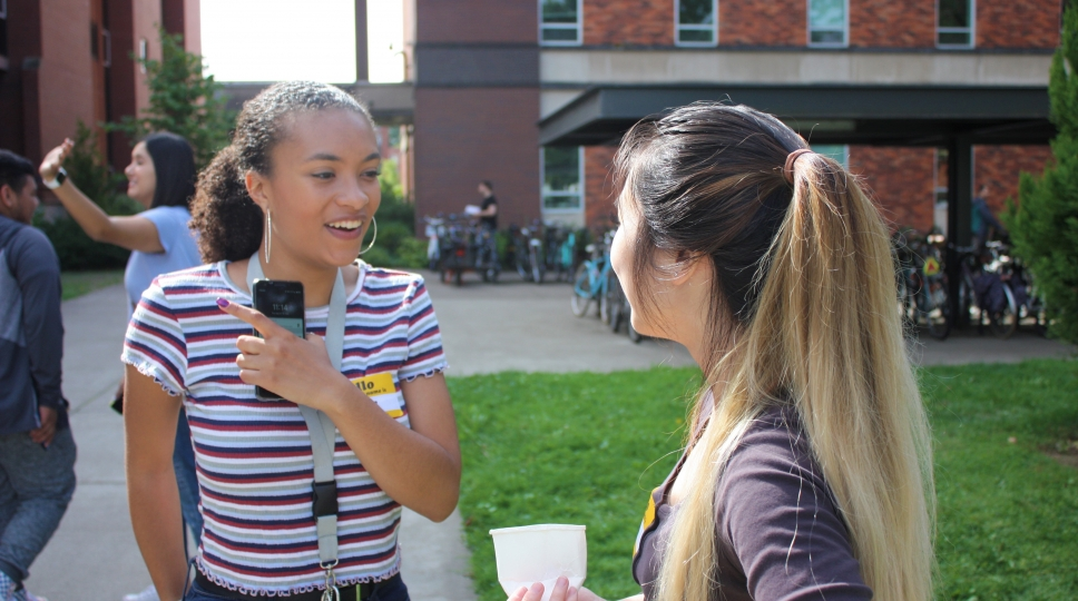 Two students in the STEM Leader Program at Oregon State talking outside.