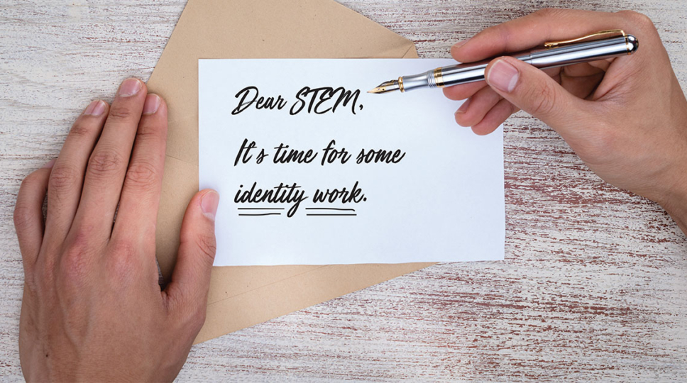"""One hand presses a postcard against an open envelope, while another hand pens the message: """"Dear Stem, It's time for some identity work."""""""